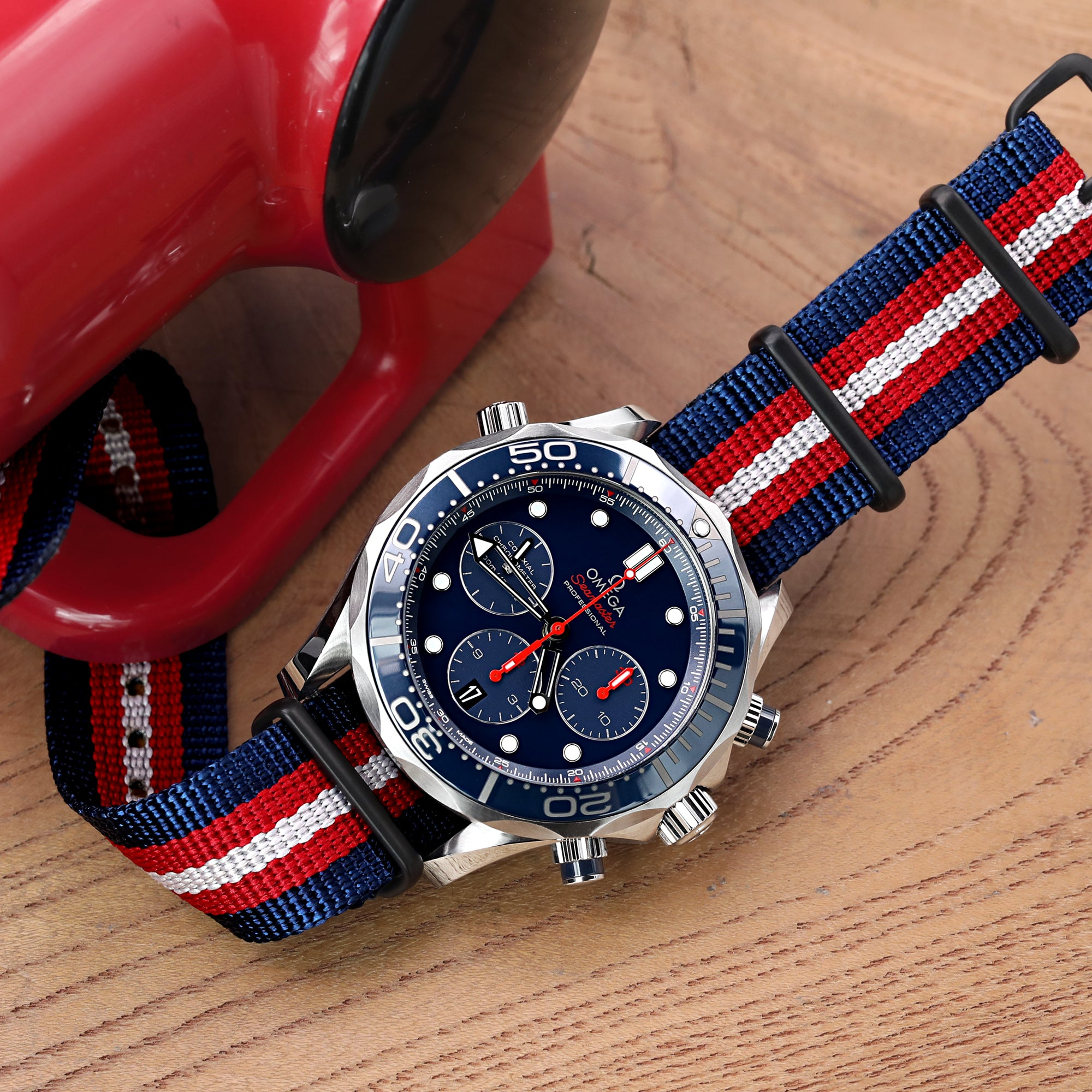 MiLTAT 20mm 21mm or 22mm G10 NATO Bullet Tail Watch Strap Ballistic Nylon PVD Blue Red & Grey Stripes Strapcode Watch Bands