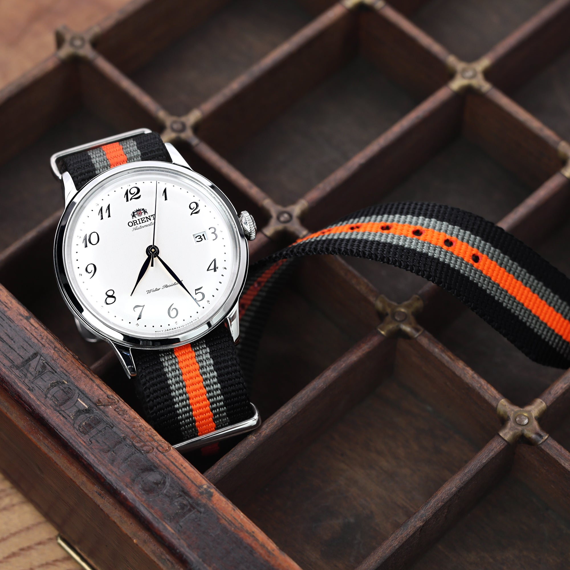 MiLTAT 21mm or 22mm G10 NATO Bullet Tail Watch Strap Ballistic Nylon Polished Black Grey & Orange Stripes Strapcode Watch Bands