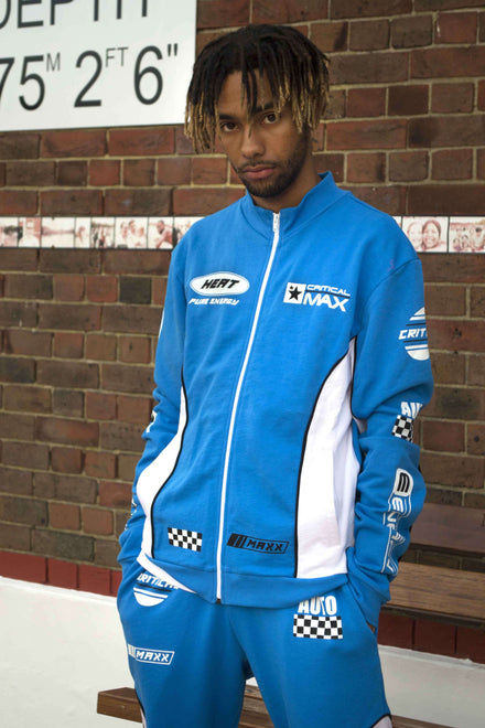 BLUE TRACKTOP WITH RACING PRINTS