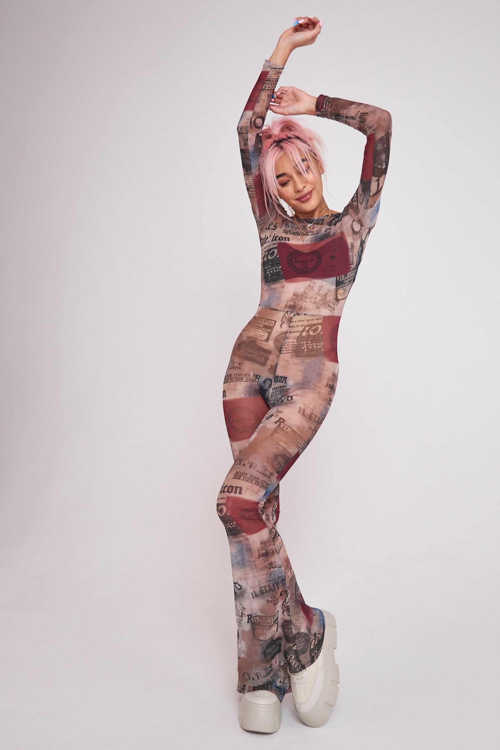 Newspaper Print Mesh Flared Leg Catsuit