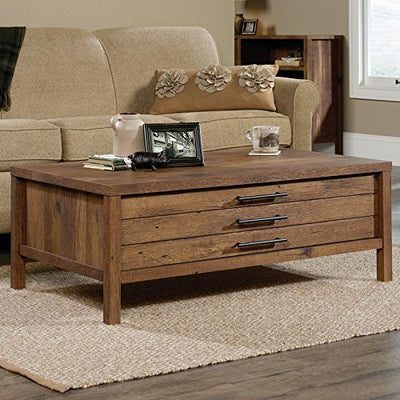 Add This Coffee Table Made of Particle Board in Vintage Oak Color And Large Drawer for You To Storage and Organize