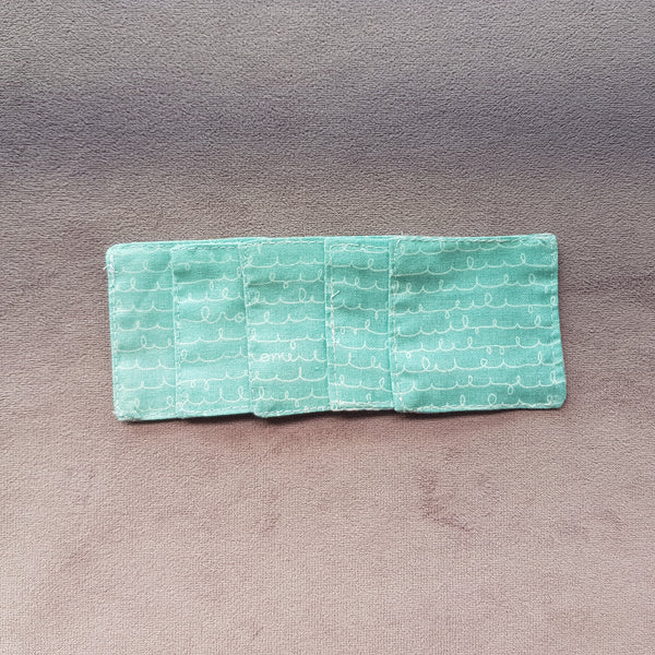 Blue-green cotton facial pads