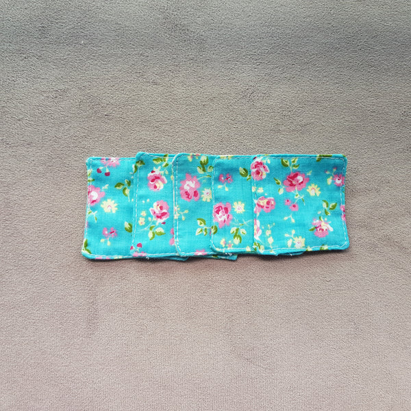Roses on blue cotton facial pads