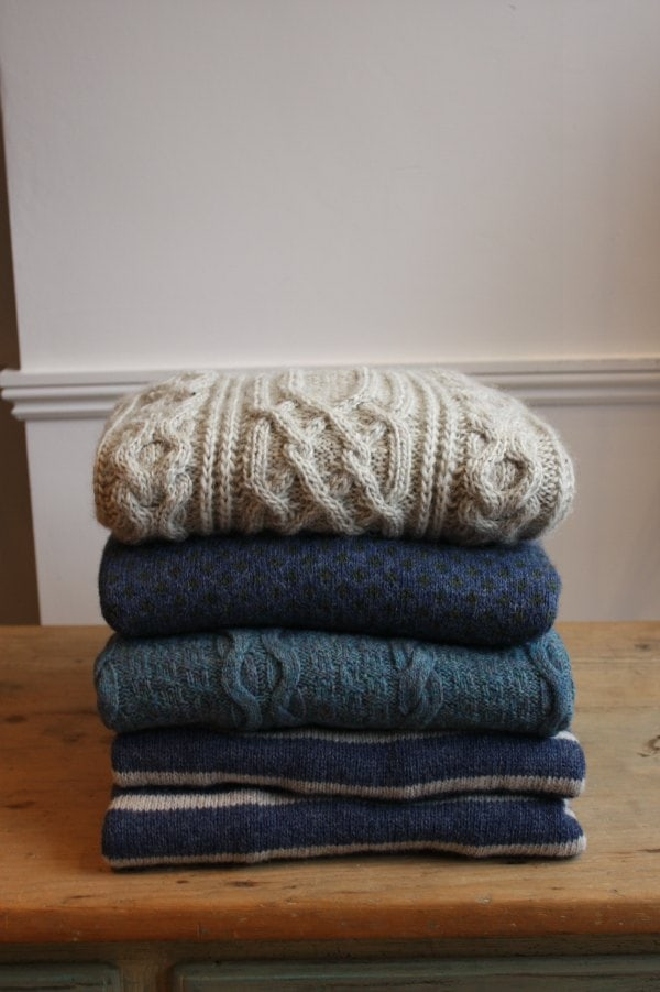 folded wool sweaters