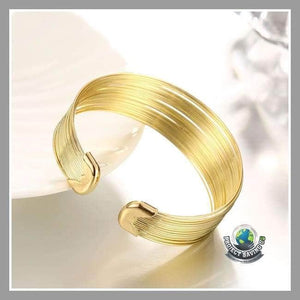 Womens Gold Hypoallergenic Bangle (FH) - Bracelets