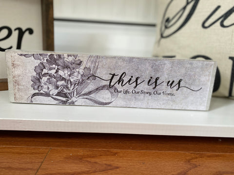 "White Floral ""This is Us"" Distressed Wood Sign"