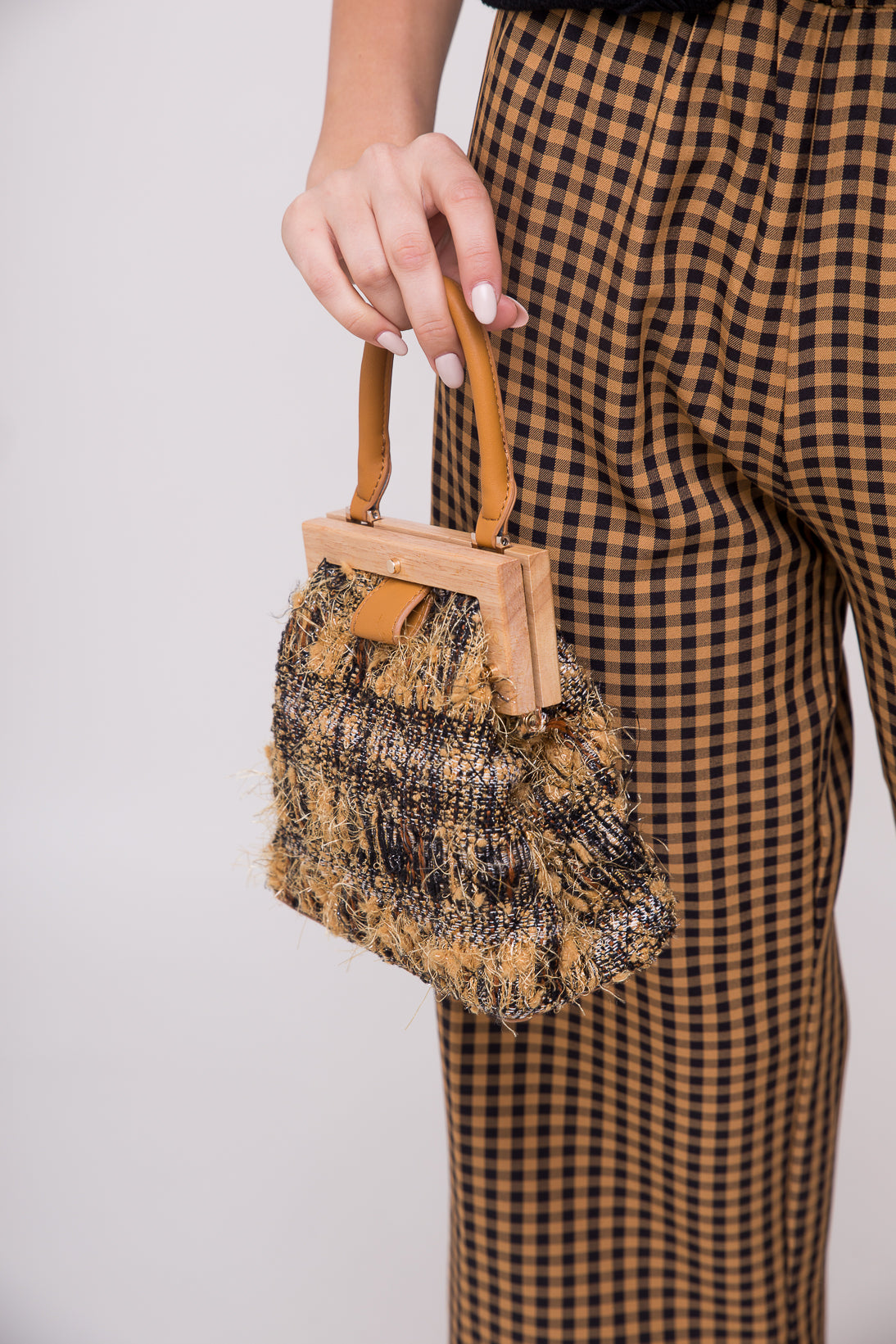 little tweed tote is an elegant and sophisticated way to stow your essentials. Note: comes with additional strap