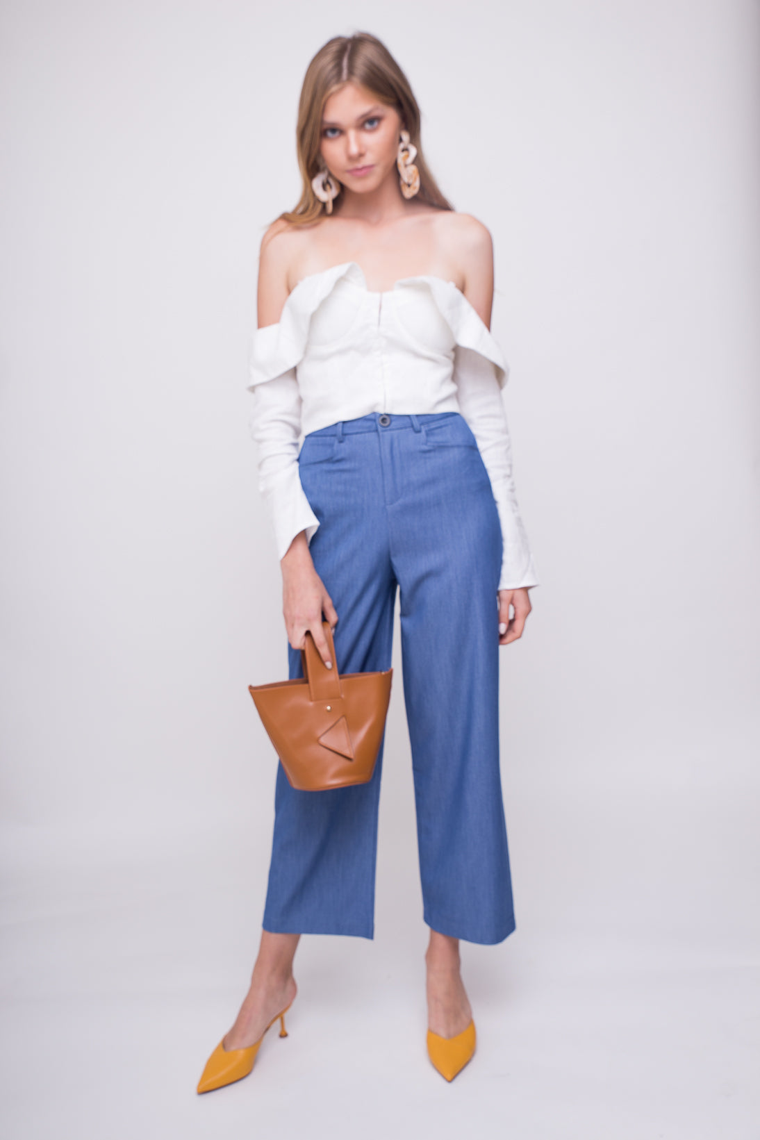 Light weight, high waist, play on denim loose dress pants.