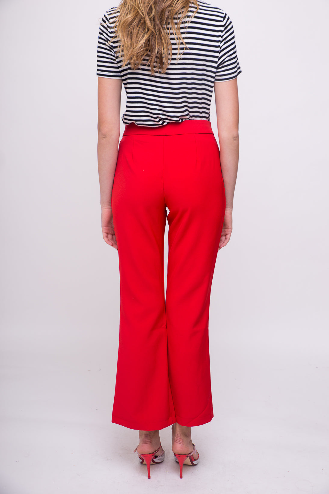 Hot red tailored dress pants.