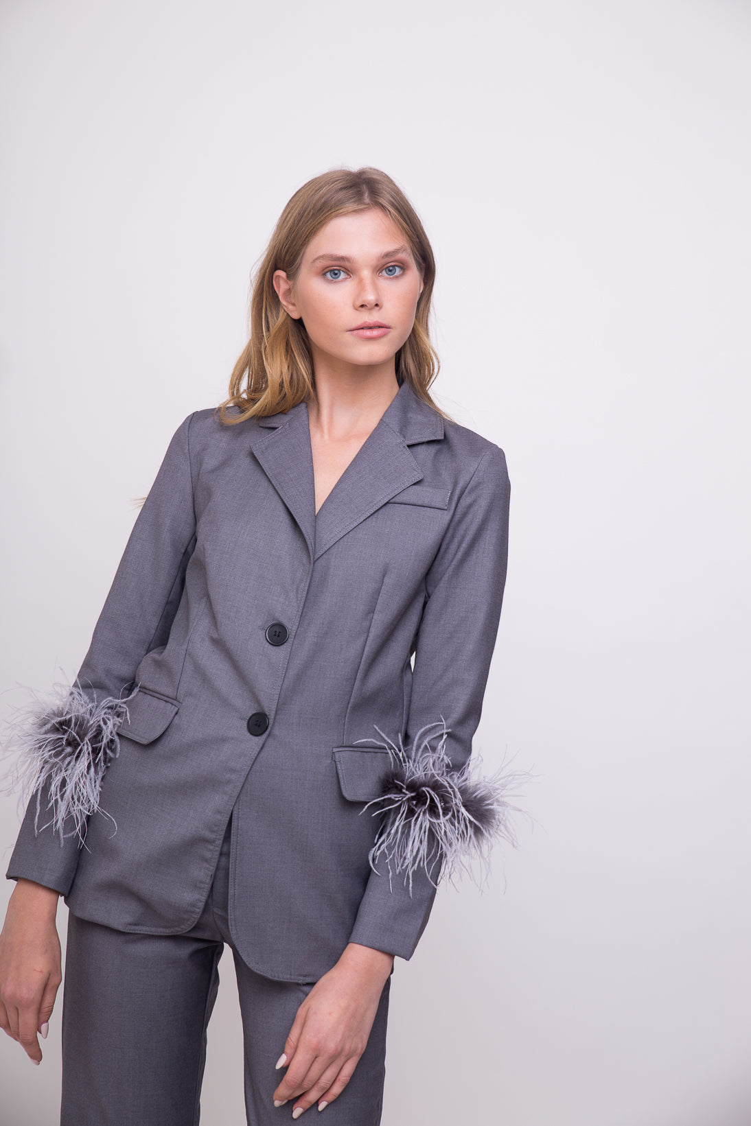 Elegant grey suit jacket with feathered details.