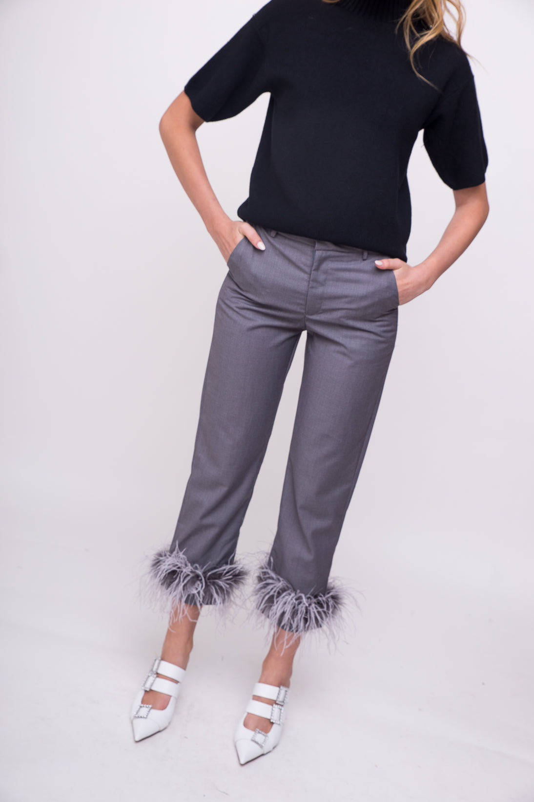 Elegant grey dress pants with feathered details.