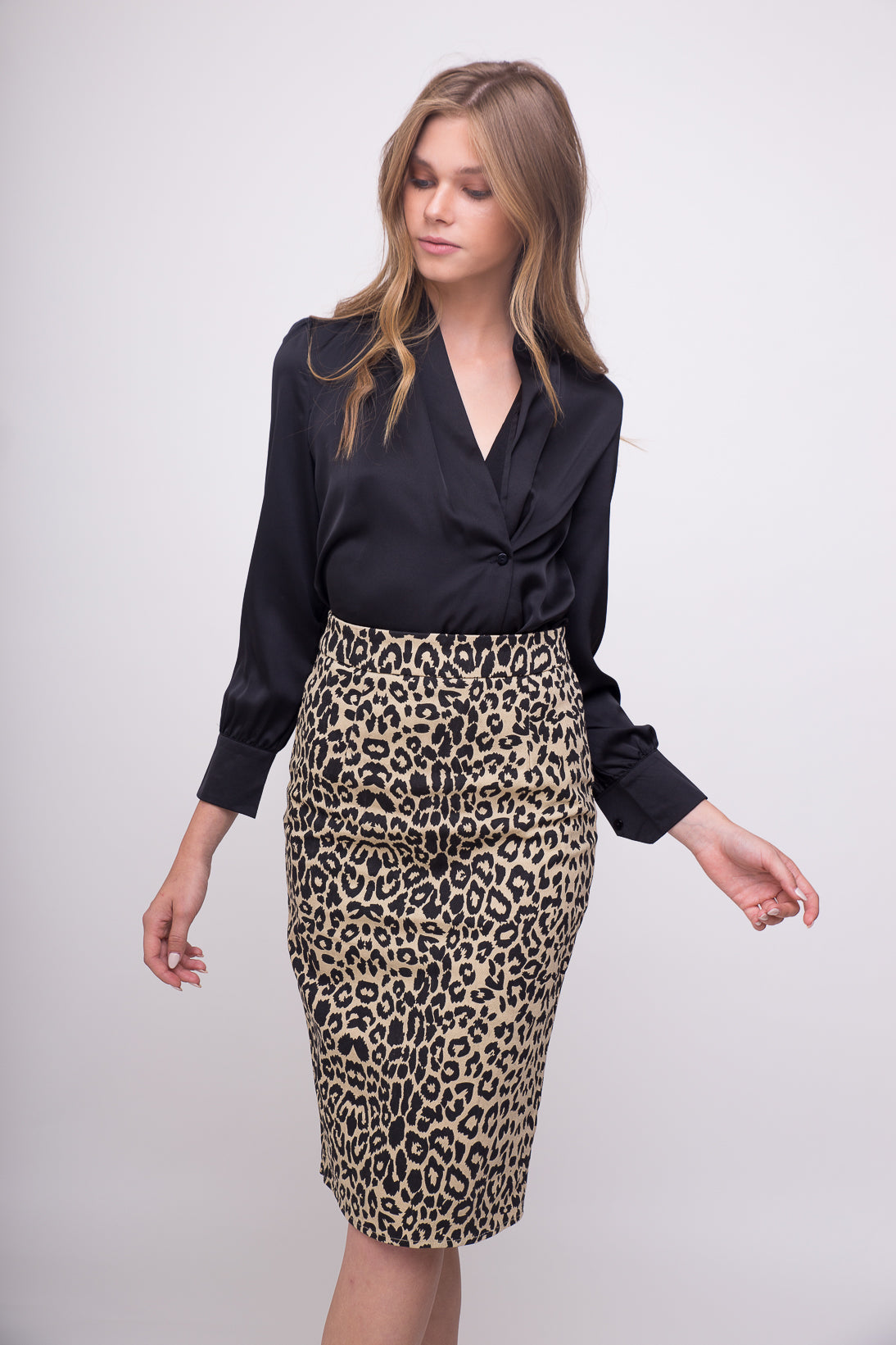 Leopard print denim skirt.