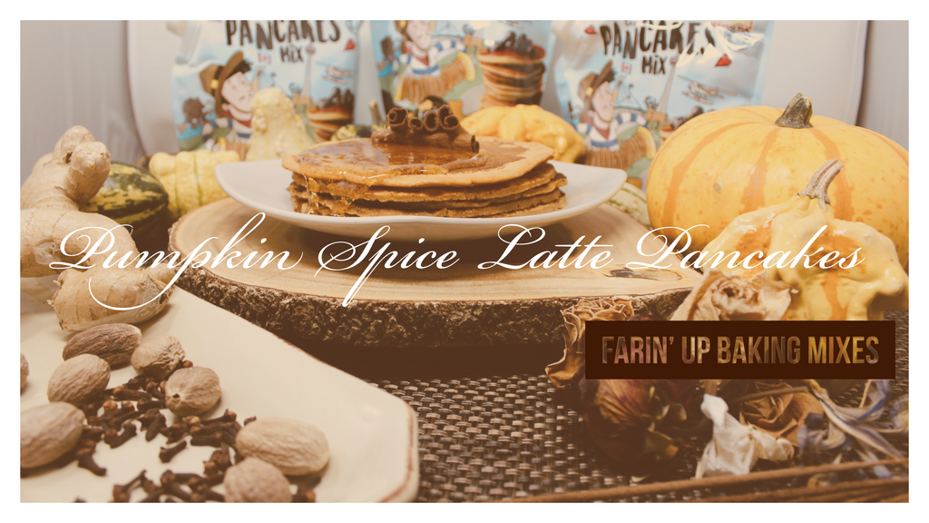 Picture of Pumpkin Spice Latte Pancakes with agave dripping down the pancakes on plate on top of wooden cut surrounded by fall autumn ornament decorations, pumpkins, spices, ginger, nutmeg, cloves, cinnamon