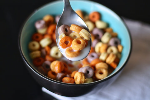 Bowl of cereal with milk and spoon