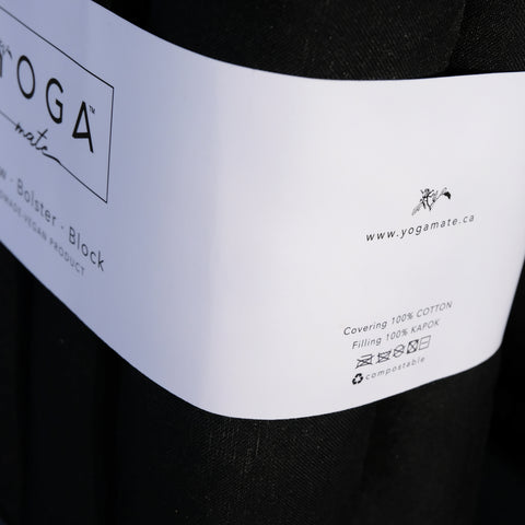 close up on yoga mate bolsters label which reads 100% cotton and kapok