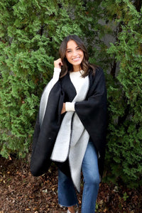 Reversible women's black and gray shawl poncho style front.