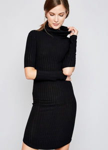Woman in faded black knitted dress, Turtleneck, long sleeves What is cut out elbows