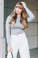Women's fitted grey ribbed sweater shirt.