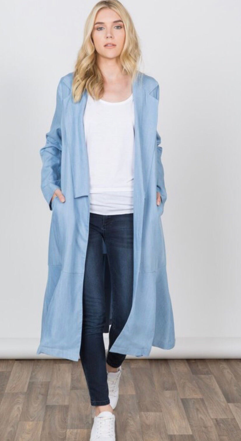 Women's light blue duster length jacket with pockets front.