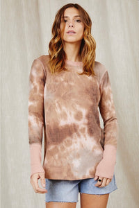 Women in long sleeve pink brown cream colored tie dye lightweight top front.