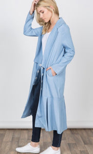 Women's light blue duster length jacket with pockets side.