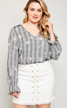 Modest plus women's wrap top flower print shirt with long sleeves and ruffle details front.
