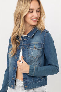 Women's button up waist length blue denim jacket front.