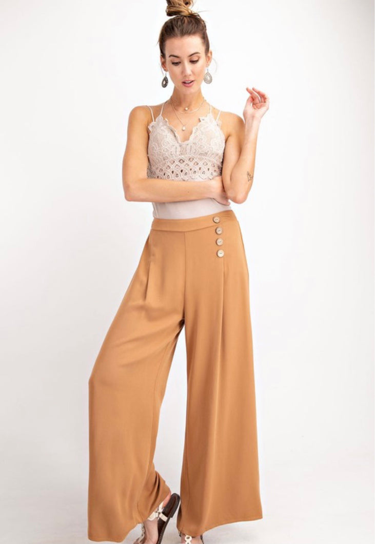 Light brown wide leg women's trousers with button details on waist.