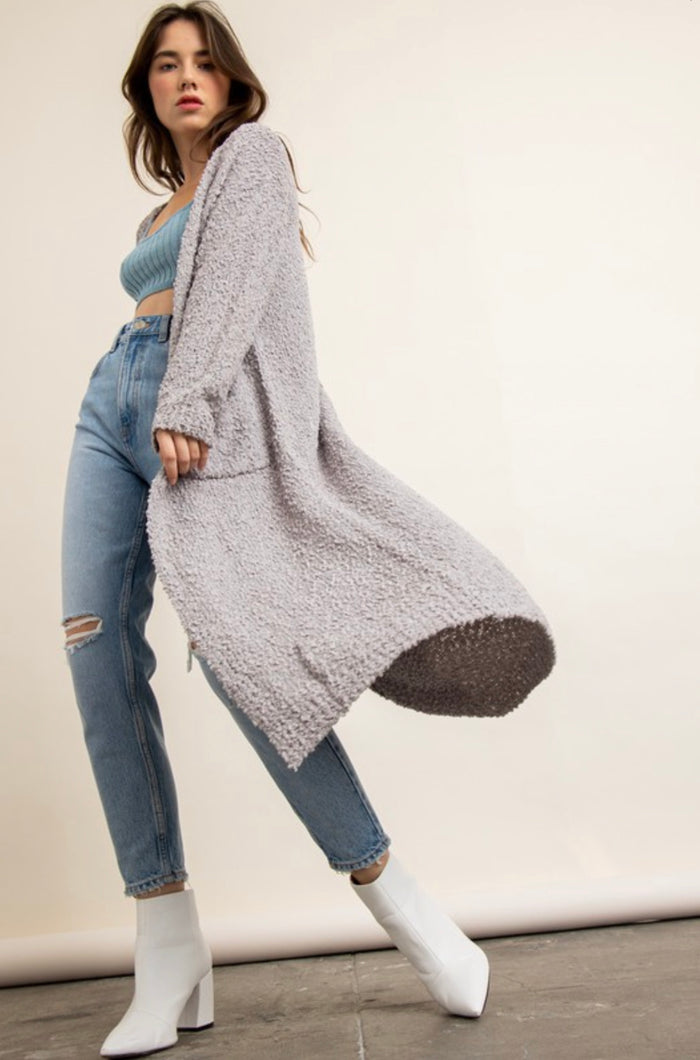 Grey textured women's long duster cardigan with pockets side.