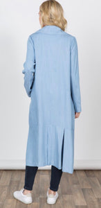 Women's light blue duster length jacket with pockets back.