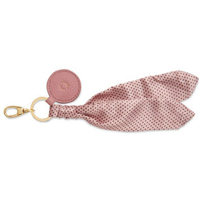 Katie Loxon Carrie Pink Scarf with black polka dots keychain bag charm with gold clip and pink round tag front.