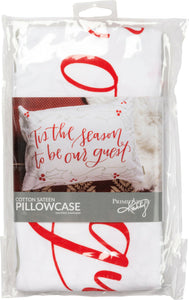 "White pillowcase with ""Tis The Season"" red graphic lettering on front."