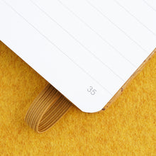 Load image into Gallery viewer, Cork bound notebook with lined pages and back pocket - Ochre