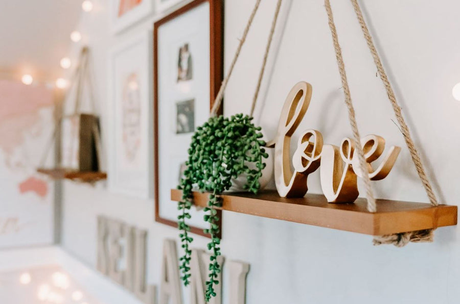 LOVE sign on brown wood shelf
