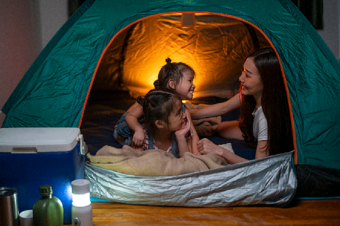 Family in green tent