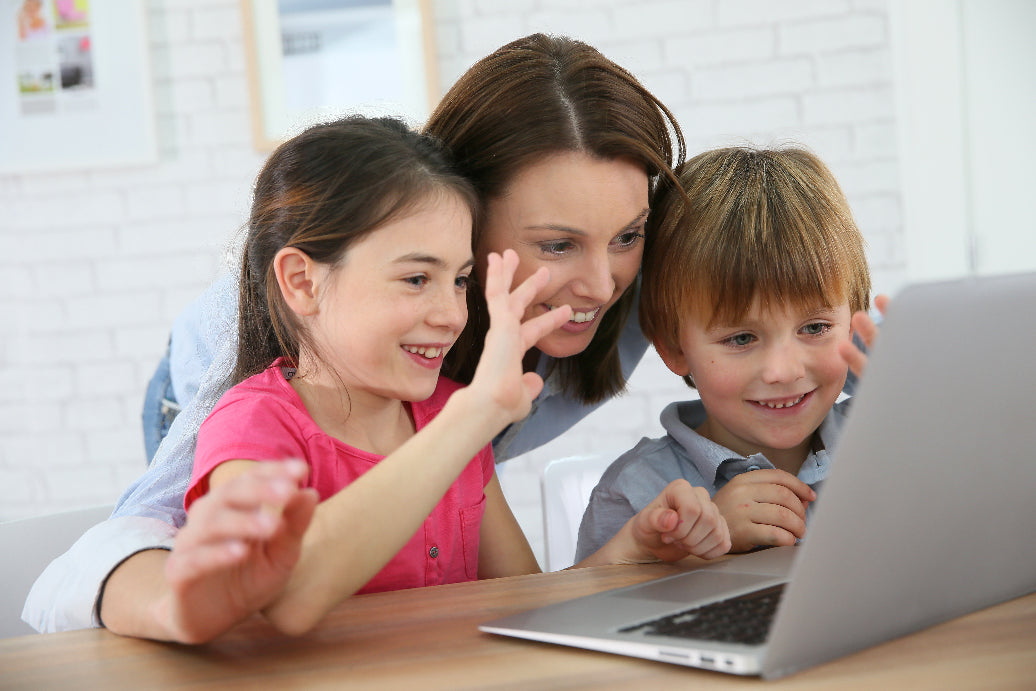 Mother and children skype with family