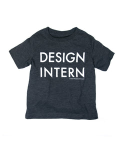 a charcoal gray t-shirt with the phrase Design Intern printed in large, white letters on the front