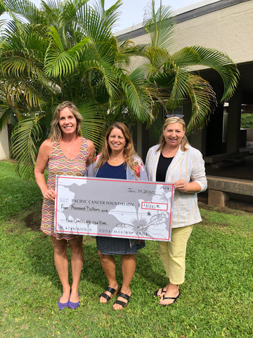 Nancy LaJoy accepts donation from Jen and Jan, Pono Chocolate Founders in Spring 2020