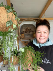 Stephanie in the Artful Green Potting shed amongst her plants