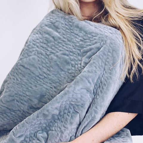 girl wrapped in a weighted blanket