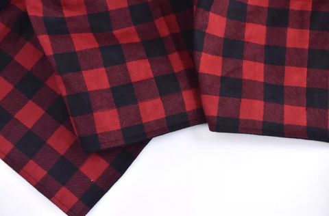red plaid weighted blanket fabric showing thread work