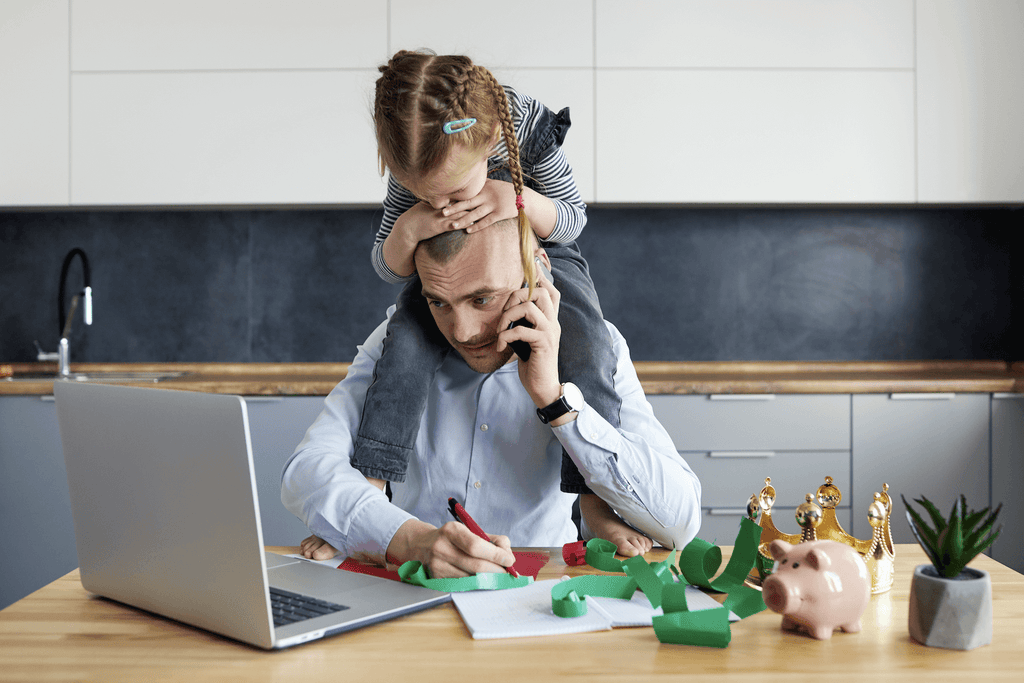 types of stress: dad trying to work while his kid is trying to get his attention