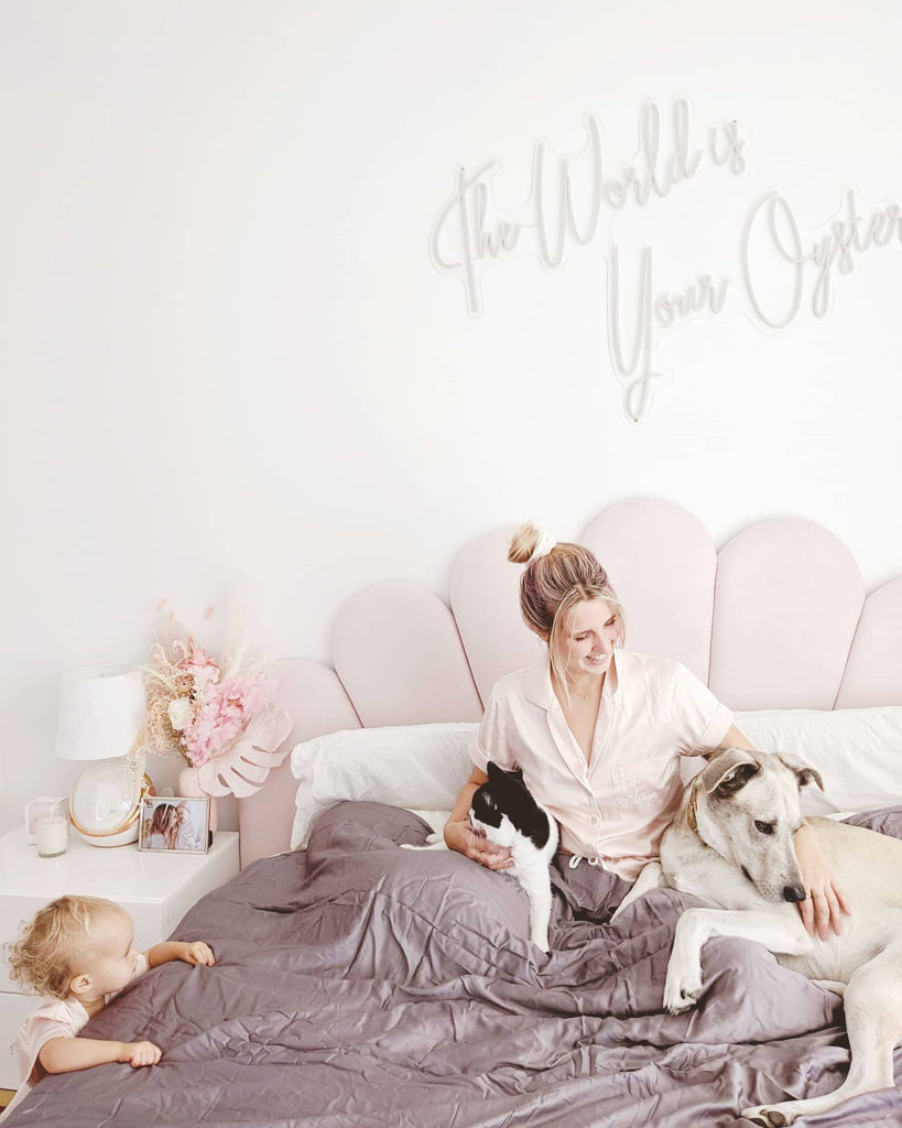 happy woman with her dogs and baby