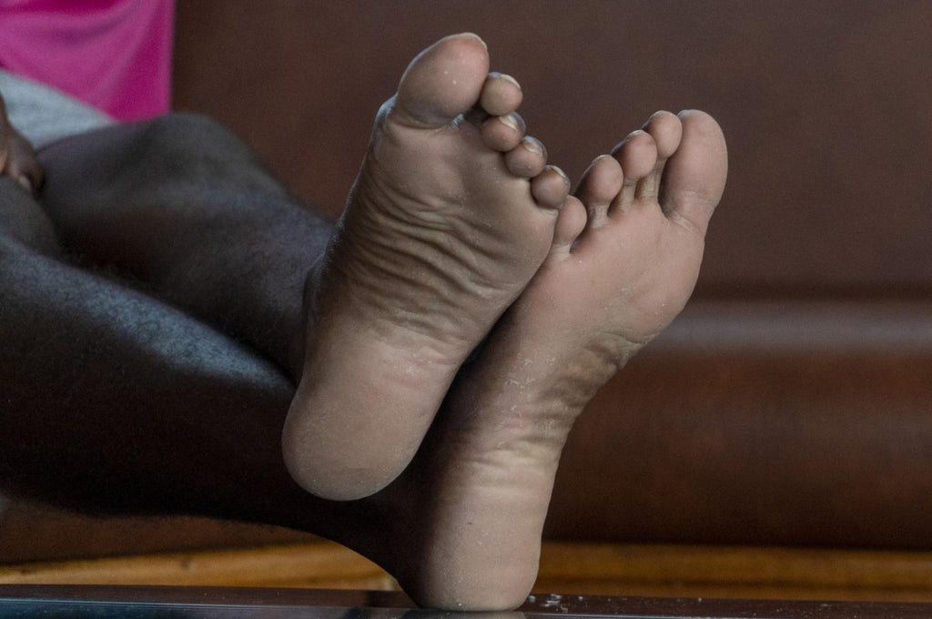 weighted blanket for restless legs: Photo of a person's feet