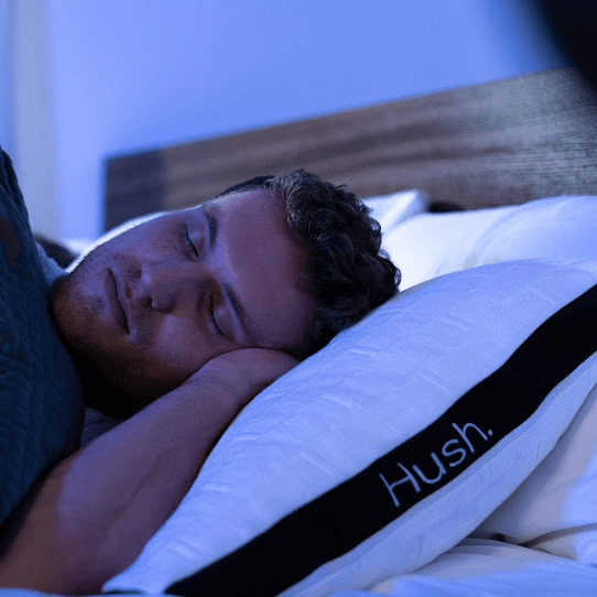 how to fall asleep in 10 seconds: Man sleeping with a weighted blanket