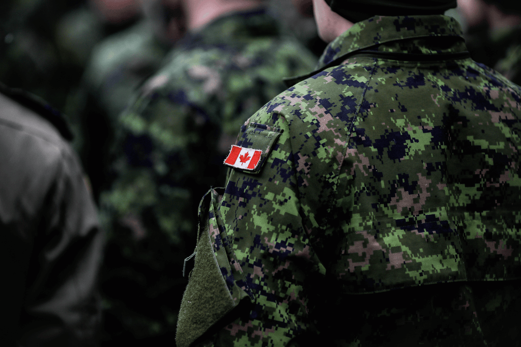 how to fall asleep in 10 seconds: Soldier wearing a military uniform with a small Canadian flag on his right upper arm
