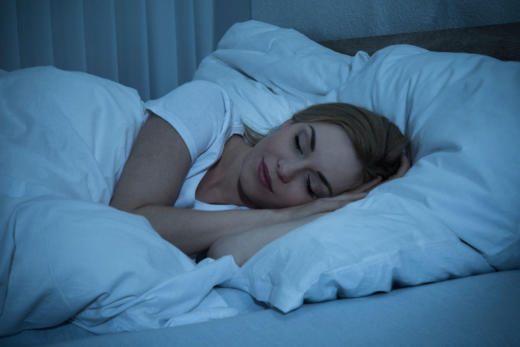 stress relief gifts: woman asleep in bed