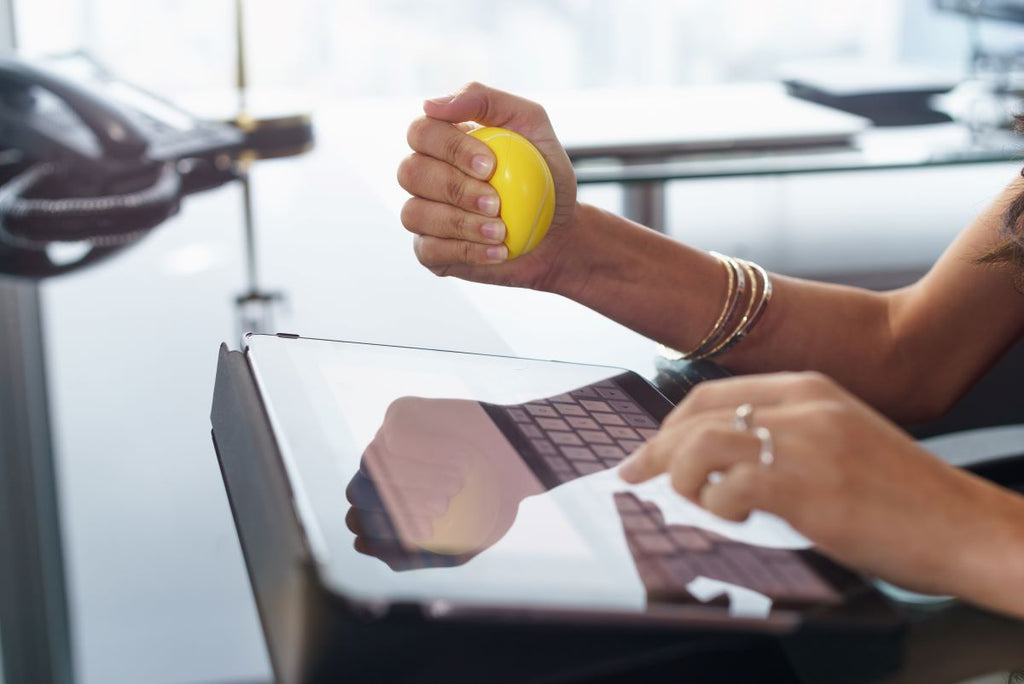 person squeezing a stress ball