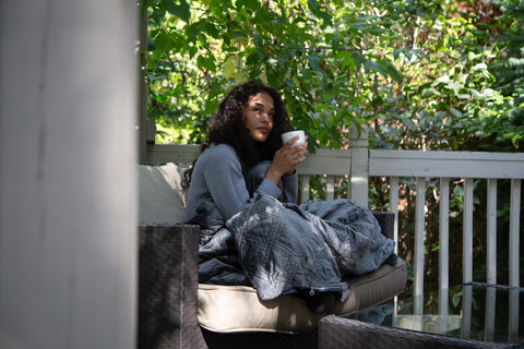 woman with coffee and hush blanket