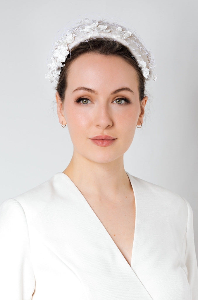 Our Ianthia veil and lace floral headband is a romantic style, which can be worn with so many bridal looks.  The headband is made from sinamay straw and the flowers are a beautiful lace, occasionally finished with a small faux pearl.  Can also be made in velour felt.  The Iathia headband would be the ideal headpiece for the bride who is looking for a soft, slightly vintage feel to complete their wedding look.  Each headband is made exclusively by hand.